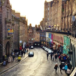 Colourful buildings on curved street in Edinburgh's Old Town, Scotland
