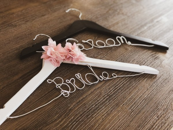 Rustic White Bride hanger with 2 Pink Lace Flowers and Silver Wire, and Black Groom Hanger with Silver Wire