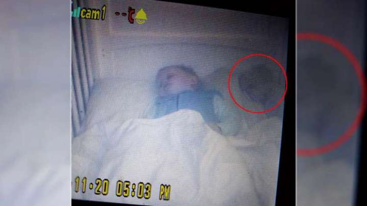 Horrified mother discovering a ghost baby in the crib with her 18-month old son