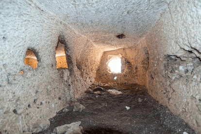 Ancient rock-cut chambers are found on a cliff in Abydos, Egypt