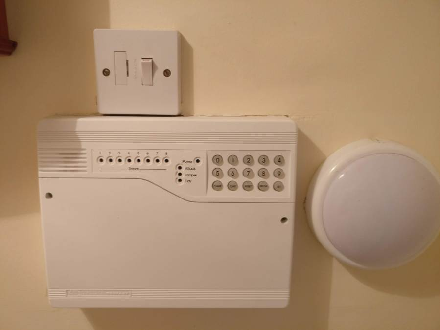 Accenta Alarm Box with isolation switch above and LED light to the side.