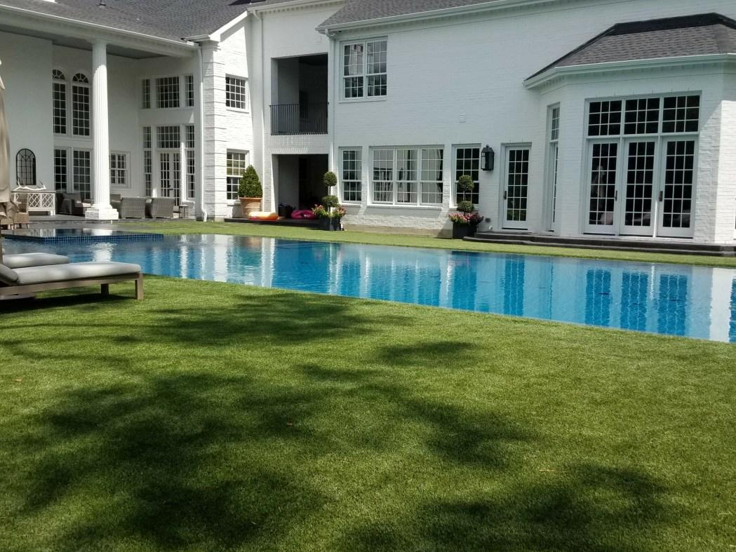 artificial grass surrounding pool