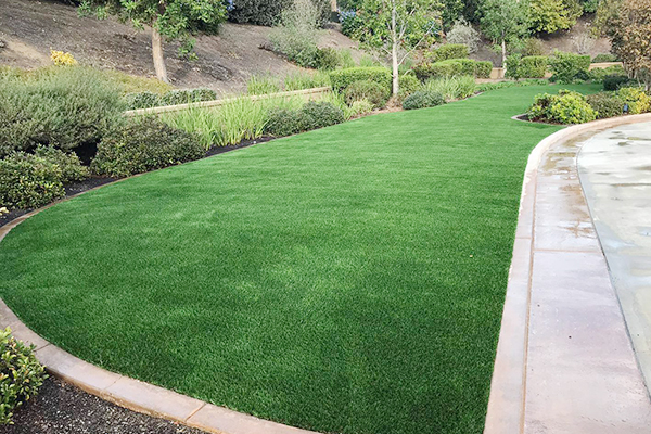 backyard landscaping with synthetic grass