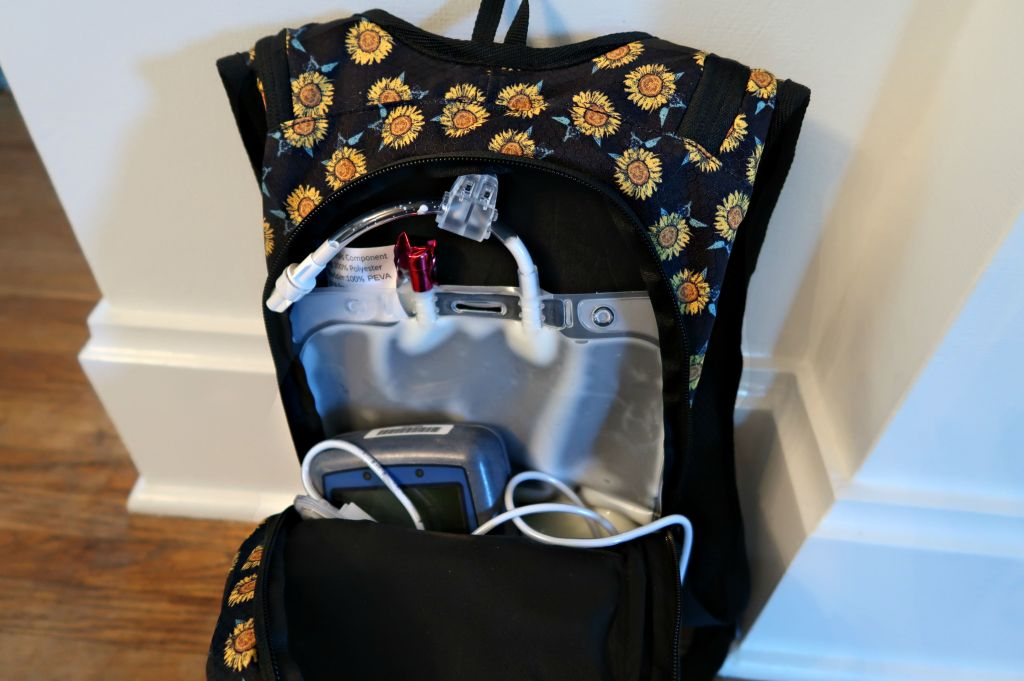Backpack interior with velcro loop to hang IV bag
