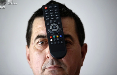 Buljubasic, 56, poses with a TV remote on his head in Srebrenik
