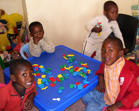 Preschool children having fun with new toys