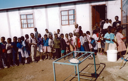 Children patiently wait for their warm nutritous food
