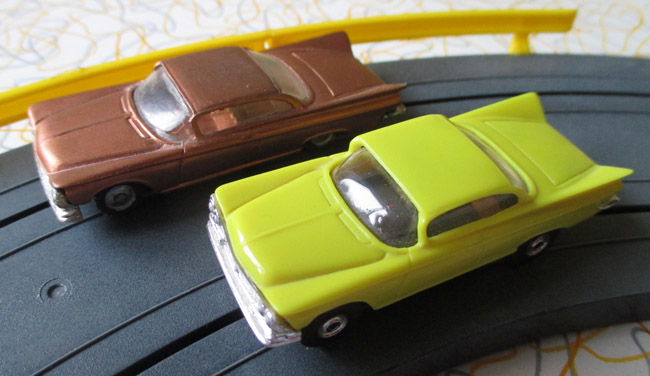 The original Husky 1959 Buick model (left) is a bit longer than the MEV slot car.