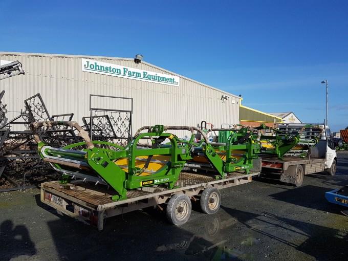 Hustler dealer Johnson Farm Equipment delivering another load of Hustler bale unrollers.jpg