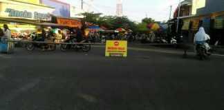 Pengumuman mengenai penutupan jalan di Pasar Kutukan. Foto oleh Arief Susanto