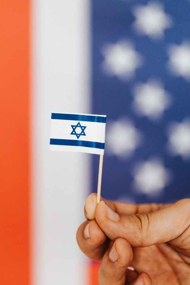 crop person with israeli flag on multicolored background