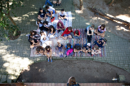Resultado de imagem para children sitting on chairs in a semi circle for story time
