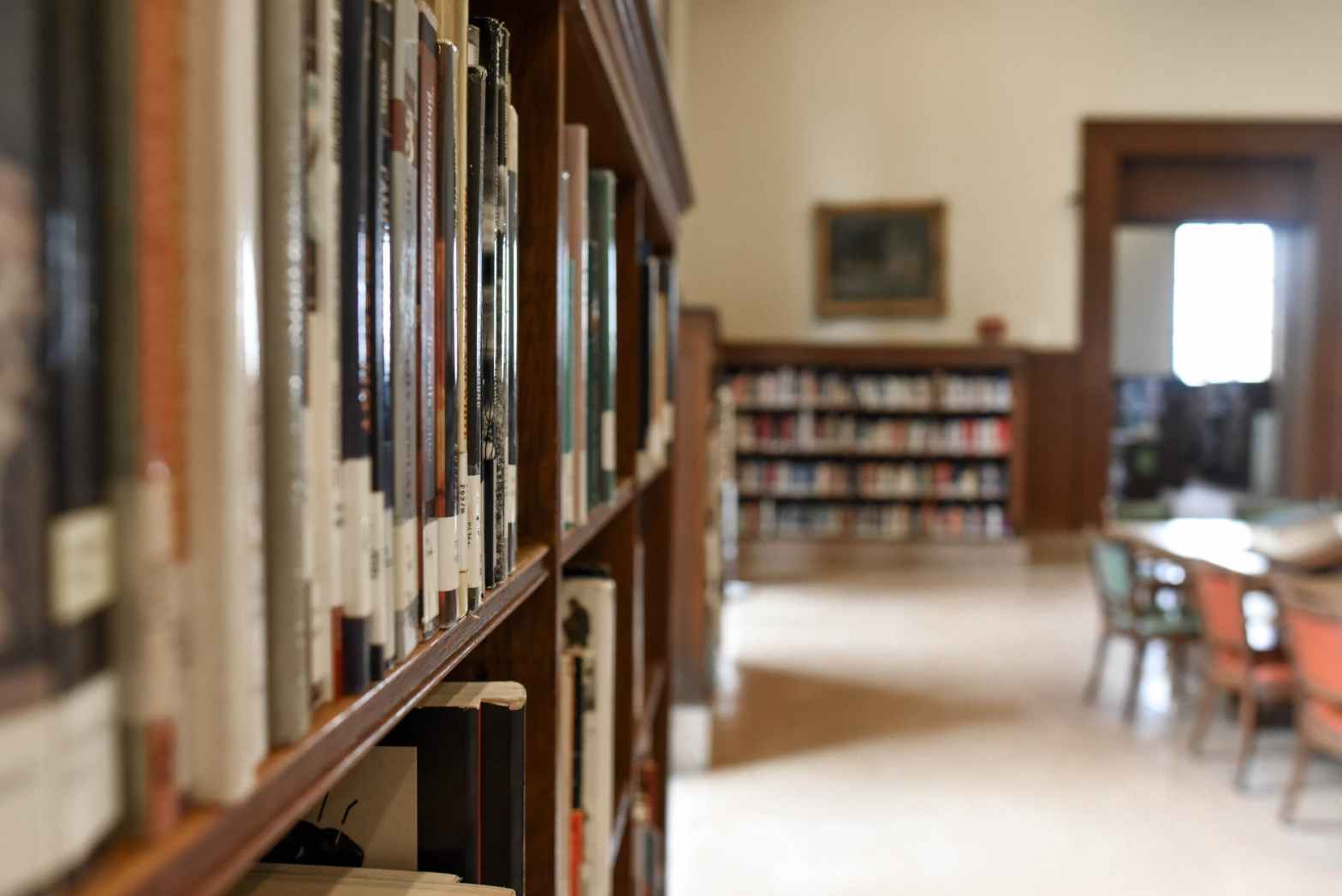selective focus photography of bookshelf with books