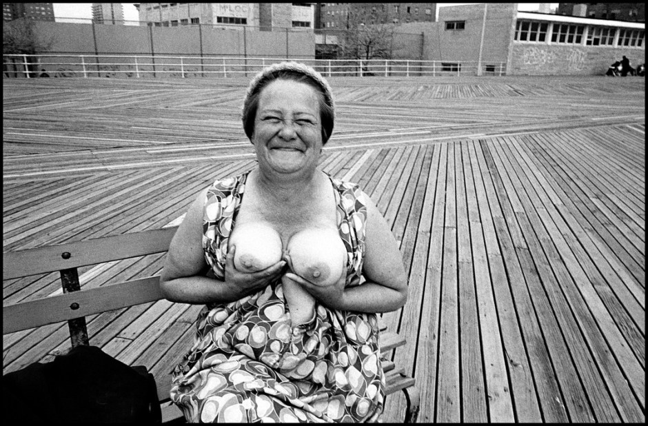 USA. NYC. Coney Island. 1977. Woman exposing her breats on the boardwalk.