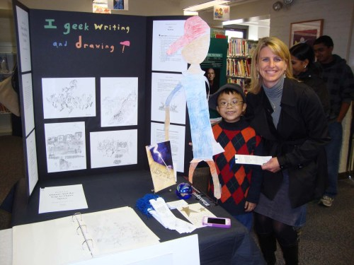 Eight years old David T. Lee having his 1st book promotion at Shrewsbury Public Library (Photo taken with Floral Street Elementary School Principal Lisa McCubrey)