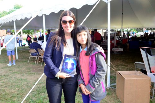 Laura T. Lee presented her 1st novel (Two Worlds) to State Representative Hannah Elizabeth Kane at Spirit of Shrewsbury Fall Festival 2016's bookselling event