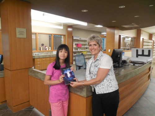 Laura T. Lee (David's younger sister) presented her 1st novel to Ellen Dolan of Shrewsbury Public Library