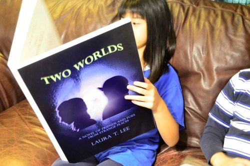 Giant replica of Laura T. Lee's first novel Two Worlds