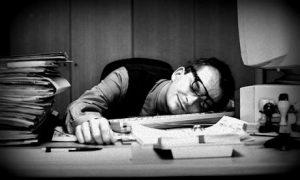 man asleep desk