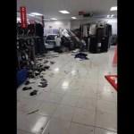 Man arrested after crashing car into shop