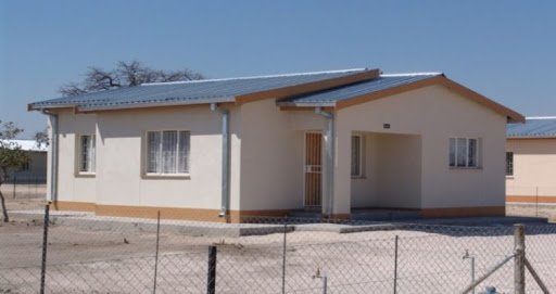 National Housing Enterprise NHE housing development projects country company constructing 335 houses