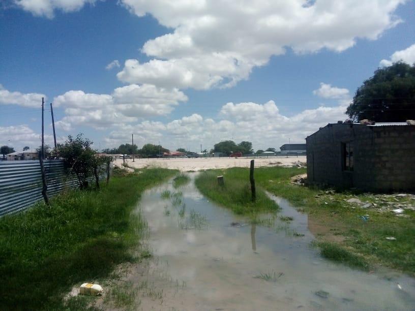 Blocked waterways Oshakati water torrential rains residences informal settlements