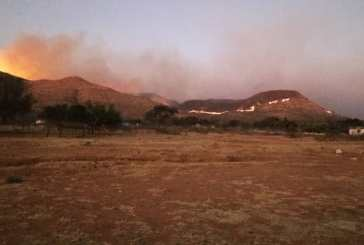 Giant bushfire fire continues to burn into the night