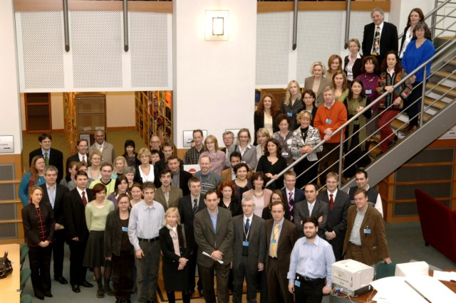 The staff of the Library of the European Parliament, at their 'Annual General Meeting' in December 2006. They are gathered for the photo on the stairs and floor of the reading room. A great team with many achievements - then and later.