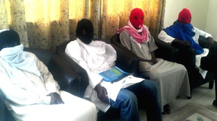 MEMBERS OF A BOKO HARAM SPLINTER GROUP INSISTING ON A CEASE FIRE AT A NEWS CONFERENCE IN MAIDUGURI