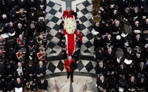 The coffin is carried as it arrives for the funeral service (Eddie Mulholland)