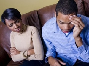 black-woman-frowning-at-black-man