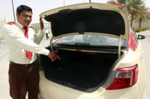 Abdul Halim pointing to the boot of his cab where he found the bag containing cash and diamonds