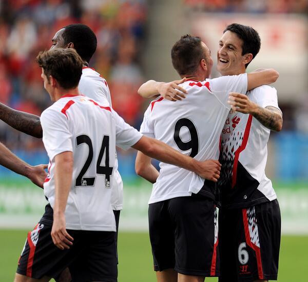Liverpool Players Celebrate After Iago Asoas' Goal.