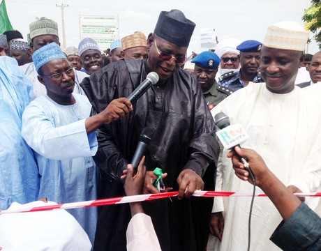 GOV. SULE LAMIDO OF JIGAWA (L), INAUGURATING DANGE SHUNI 5KM TOWNSHIP ROAD IN DANGE SHUNI LOCAL GOVERNMENT COUNCIL OF SOKOTO STATE ON TUESDAY (24/9/13). WITH HIM IS GOV. ALIYU WAMAKKO OF SOKOTO (NAN)
