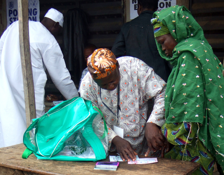 AN ELDERLY WOMEN BEING ASSISTED BY AN AGENT TO VOTE  DURING THE RE-RUN OF LOCAL GOVERNMENT ELECTION IN OFFA, KWARA,  ON SATURDAY