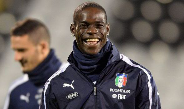 Happy as a Dancing Bear: Mario Balotelli Giggles During Italy's Training Session at Craven Cottage.