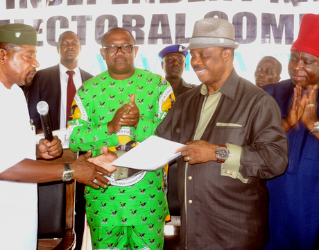 FEDERAL COMMISSIONER OF INEC IN CHARGE OF ANAMBRA, ABIA AND BENUE, CHIEF LAWRENCE NWURUKU (L), PRESENTING CERTIFICATE OF RETURN TO ANAMBRA GOVERNOR-ELECT, CHIEF WILLIE OBIANO (2ND-R), IN AWKA ON MONDAY (2/12/13). WITH THEM ARE GOV. PETER OBI (2ND-L) AND THE NATIONAL CHAIRMAN OF APGA, CHIEF VICTOR UMEH (R).