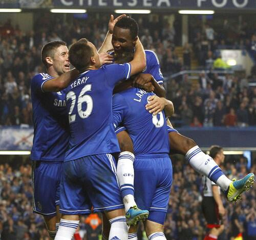 John Obi Mikel Celebrates With Teammates During Their Victory Over Fulham at Stamford Bridge.