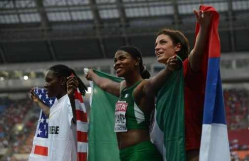 Okagbare Stands on the Podium in Moscow Along With Britney Reese of America.