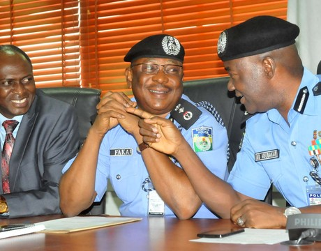 IGP MOHAMMED ABUBAKAR (R), DISCUSSING WITH THE DIG ADMINISTRATION, MR SULEIMAN FAKAI AND DIG CID, MR PETER GANA, DURING THE DECORATION OF THE SENIOR POLICE OFFICERS IN ABUJA