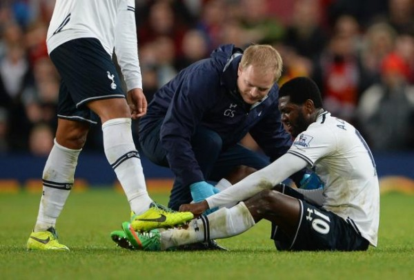 Getty Image. Adebayor Was Stretchered Off After Opening Scoring for His Club in Their 2-1 Win At Old Trafford.