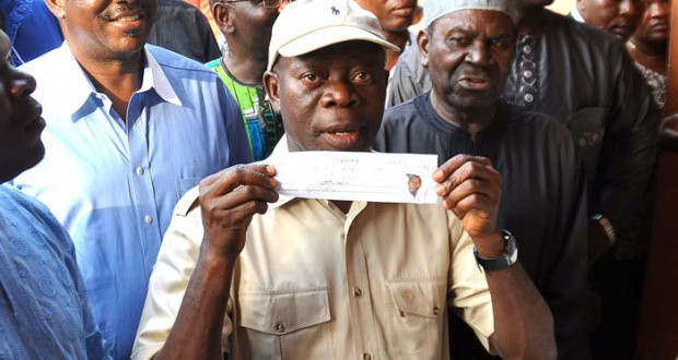 EDO STATE GOVERNOR ADAMS OSHIOMHOLE DISPLAYING HIS ALL PROGRESSIVES CONGRESS (APC) MEMBERSHIP CARD AFTER REGISTERING AT IYAMHO, ETSAKO WEST LOCAL GOVERNMENT AREA.. YESTERDAY