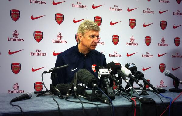 Wenger Wants Arsenal to Keep Momentum and Not be Distracted by Other Team's Progress.