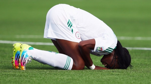 Asisat Oshoala Celebrates Scoring During the 2014 U-20 World Cup. Image: Getty.