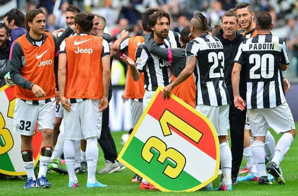 Juventus Players Celebrates After Winning the 2013/14 Scudetto Title. Image: GIUSEPPE CACACE/AFP/Getty.