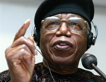 Nigerian author Chinua Achebe gestures during a news conference held during Frankfurt bookfair October 12, 2002.