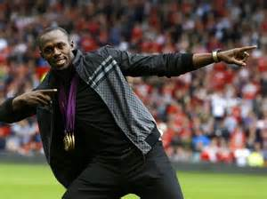 Bolt Pose With His Three Gold Medals at Old Trafford After the London Olympics.