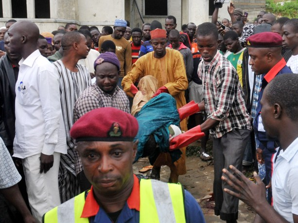 RESCUE WORKERS EVACUATING REMAINS OF PEOPLE KILLED IN AN UNCOMPLETED BUILDING BY UNKNOWN GUNMEN AT APO ZONE E IN ABUJA