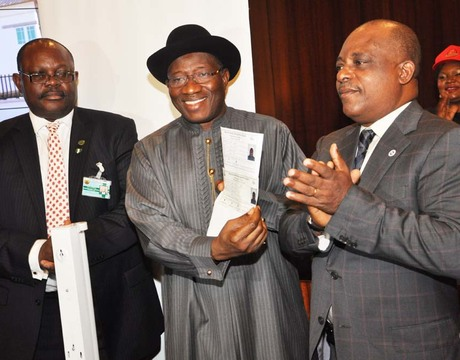 FROM LEFT: DIRECTOR-GENERAL, NATIONAL IDENTITY MANAGEMENT COMMISSION (NIMC), MR CHRIS ONYEMENAM; PRESIDENT GOODLUCK JONATHAN AND THE NIMC BOARD CHAIRMAN, PRINCE UCHE SECONDUS, AT THE OFFICIAL LAUNCH OF THE NATIONAL IDENTITY PROGRAMME AT THE PRESIDENTIAL VILLA IN ABUJA ON THURSDAY (NAN)