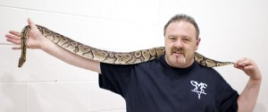 Richard Parrinello of Snake Man's Exotics from NY state poses for a photograph with a ball python wh